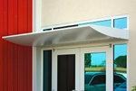 Wing awning with custom perforated sheet metal and recessed lighting for office building.