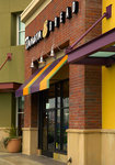 Angular awning with a rigid valance, for Panera Bread retail store.
