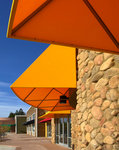 Angular fabric awning, in yellow, red, blue, or green Firesist fabric, for Cherry Glen Plaza, Sunnyvale, California.