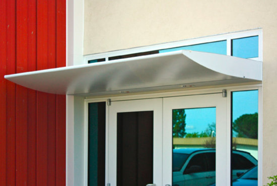 Wing Awning With Custom Perforated Sheet Metal And Recessed Lighting For Office Building